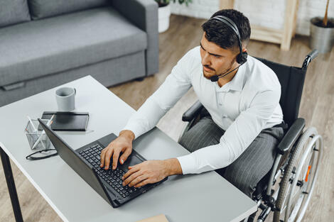 disabled man working from home